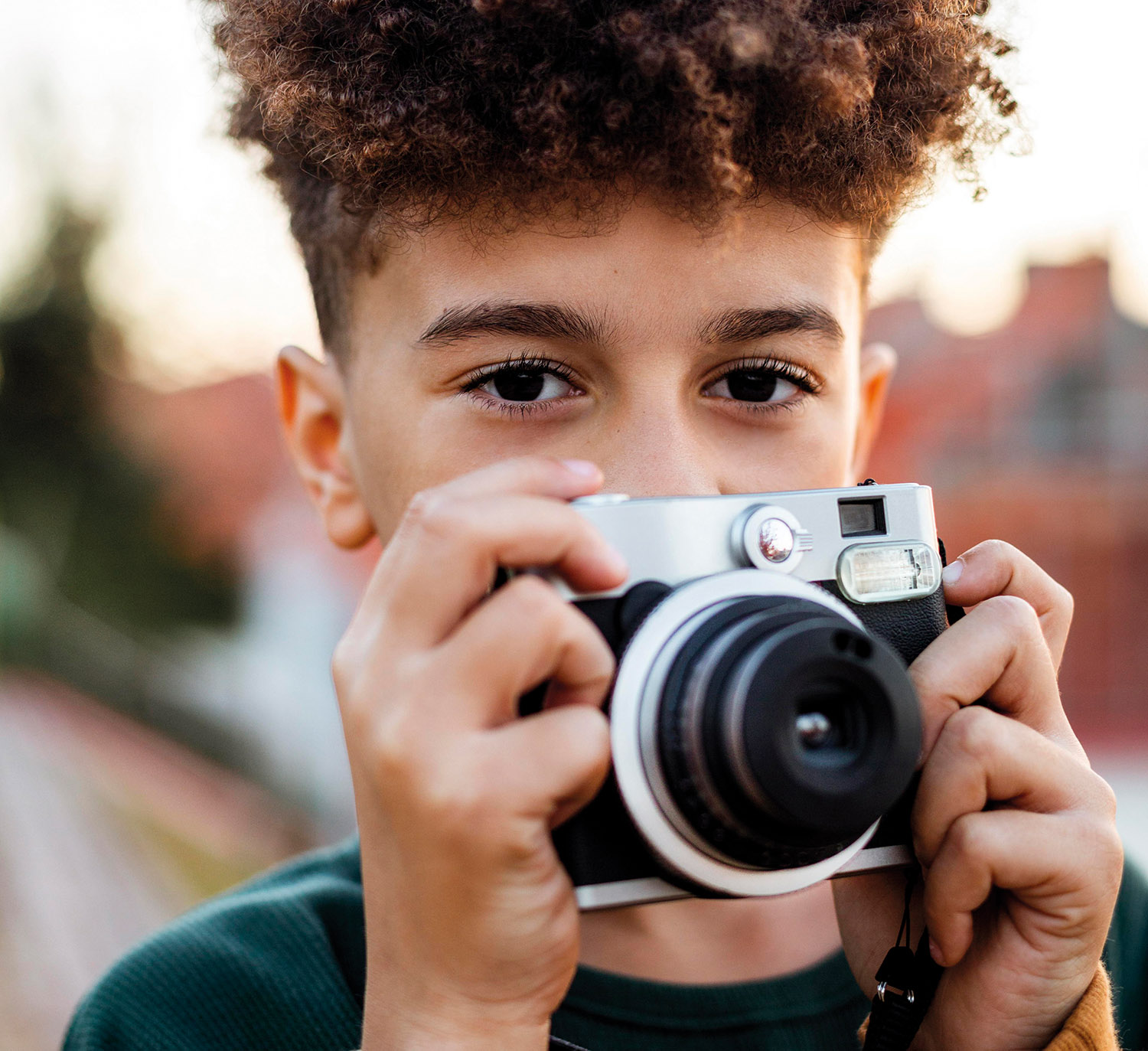 little-boy-taking-photo-with-his-camera-outside